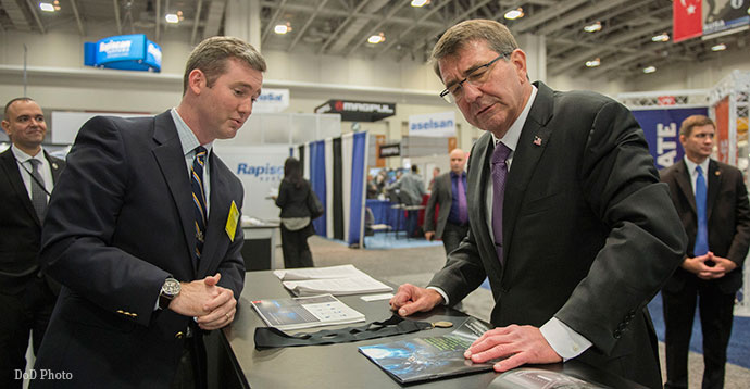 Secretary of Defense Ash Carter speaks with an exhibitor at the Association of the U.S. Army conference.